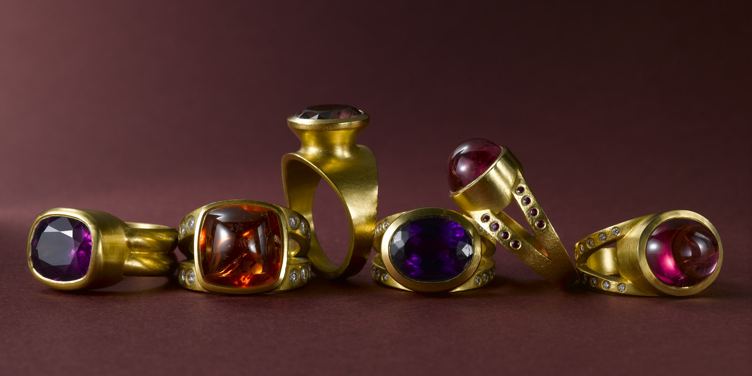 Raspberry garnet, spesartite garnet, zircon, amethyst and two bubble gum tourmaline rings set in 22 karat gold.