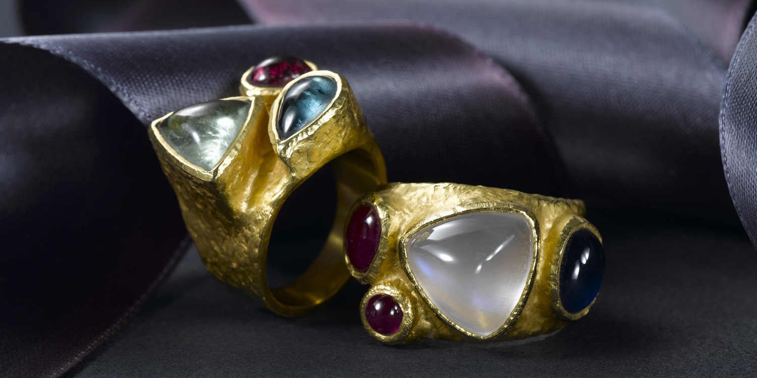 Colored tourmalines and moonstone, sapphire and ruby rings in 22 karat gold.