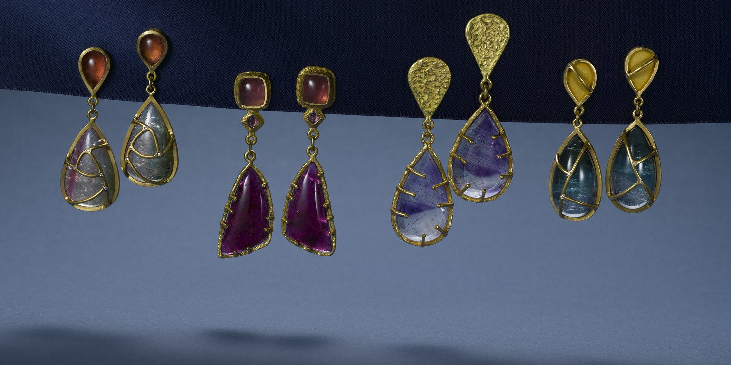 Watermelon tourmaline, rubelite, super-seven quartz, and blue green tourmaline cab earrings set in 22 karat gold.