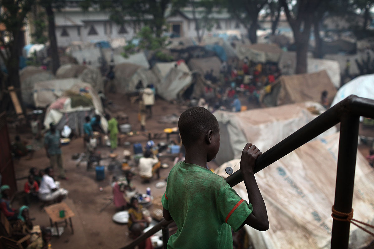 A young boy is looking at the Displaced site of Bossangoa.