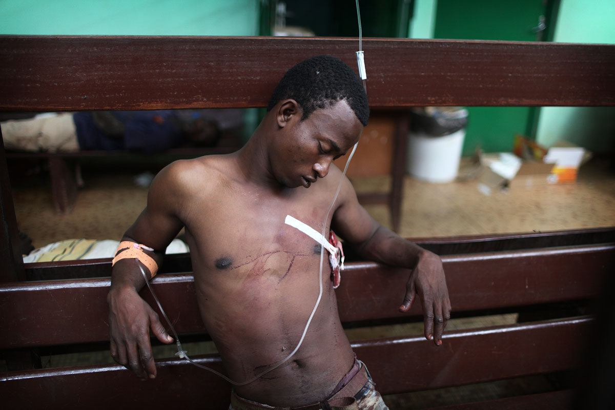 A wounded man wait for treatment at the hopital communautaire in Bangui.