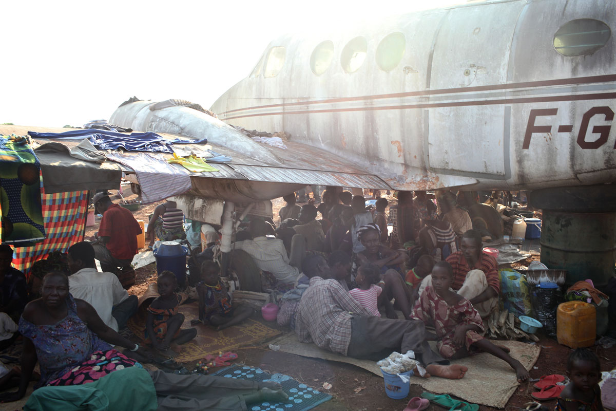 M'poko airport.Christian displaced people take shelter under old planes.the displaced site is growing everyday and the humanitarian needs are huge .