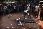 A Christian man lynch the dead body of a shop owner that people believed he was from the Seleka.