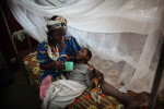 at the Pediatric center in Bangui, a woman takes care of a child abandoned by his parents