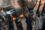 young Christians react after you burn the car of a group of Muslims who passed their neighborhood