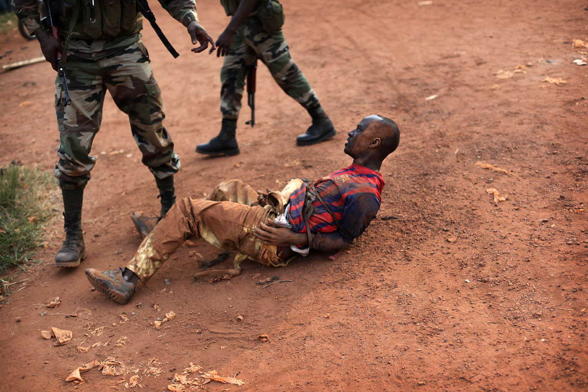 A man suspected of carrying personal grenades is arretsed by African forces .