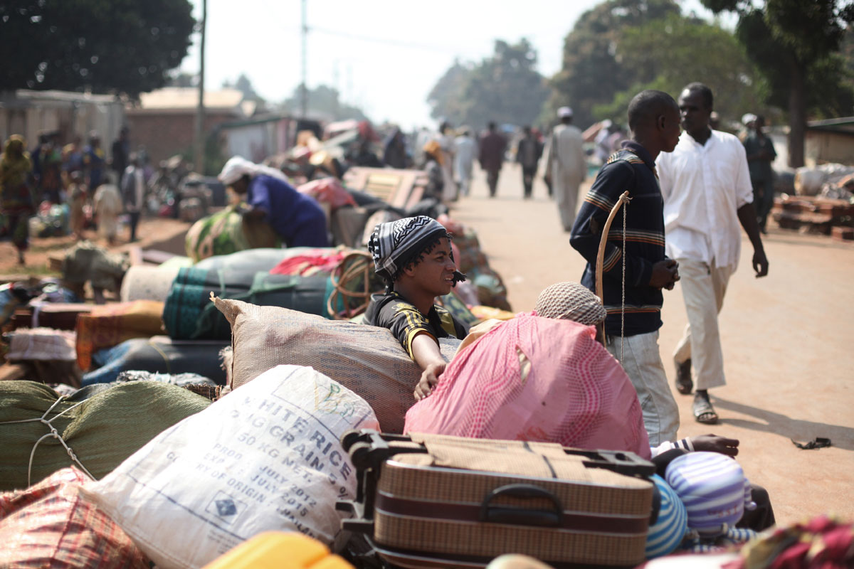 A peul woman wait for a truck to flee Bangui to the Chadian border.