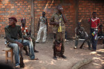 {quote}donnes moi un baton{quote}Anti balakas smoke a cigarette as they stand guard outside a secret meeting between anti balaka leaders in Bangui