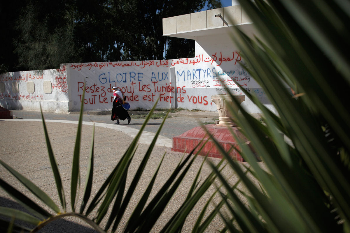 In Sidi Bouzid,hometown of Mohamed Bouazizi.the wall with all the partis,before the elections ,everyday liberals partis are taking down from the wall by Islamists.