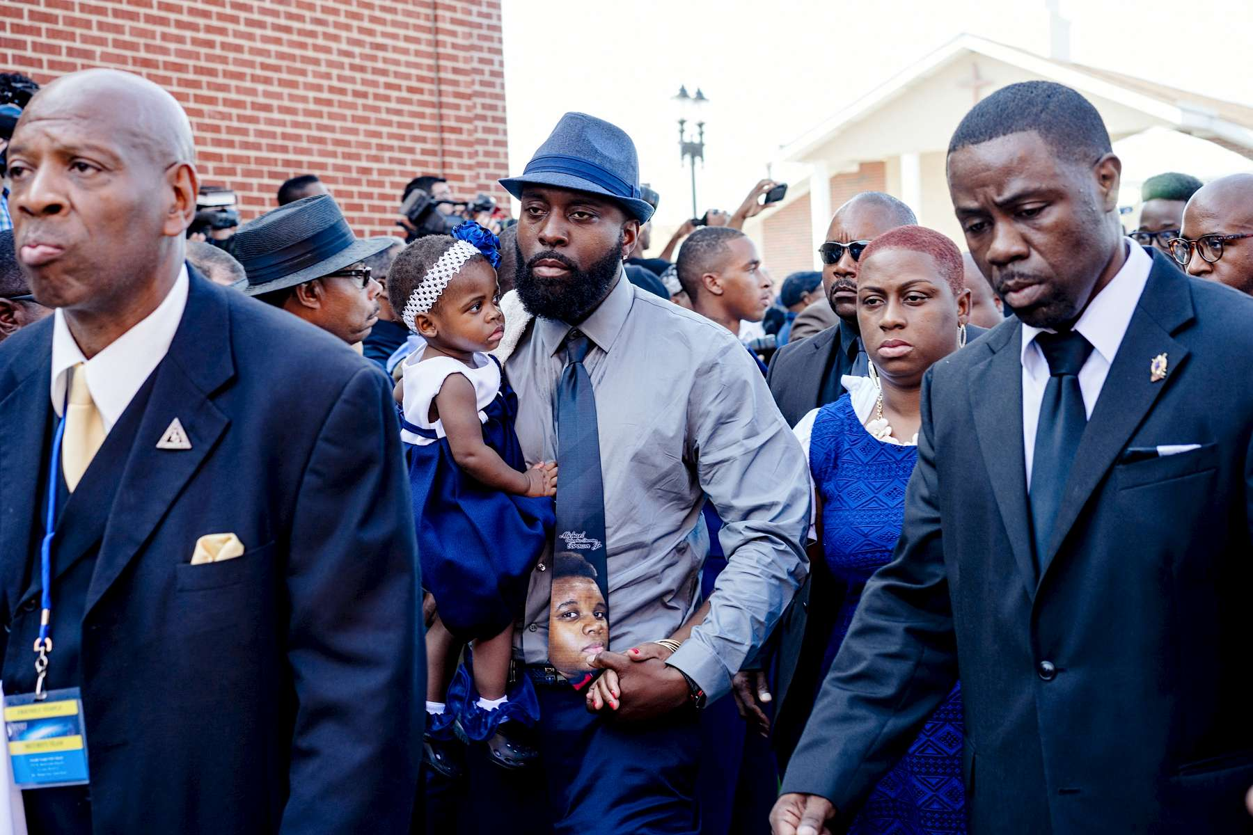{quote}A Father's Solemn Walk{quote}Flanked by family members and the Nation of Islam, Michael Brown Sr. walks into the Friendly Temple Missionary Baptist Church to attend the funeral service of his son Michael Brown Jr.