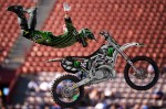 Adam Jones goes for a no-handed double seat grab during Freestyle Moto X at X Games Sixteen at the L.A. Coliseum in Los Angeles, California, on Thursday, July 29, 2010.