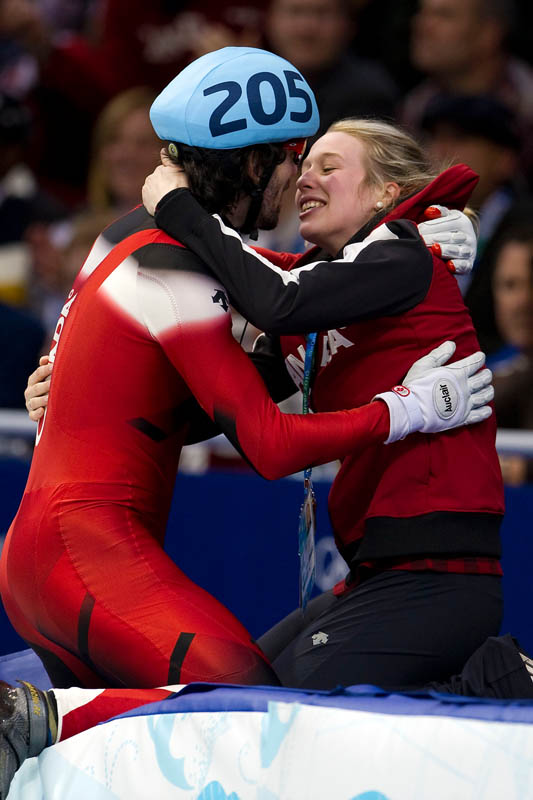 Canada's Charles Hamelin kisses his girlfriend in celebration after winning the gold medal for the men's 500m during the final night of speed skating at the Pacific Coliseum during the 2010 Winter Olympics in Vancouver, British Columbia, on Saturday, Feb. 27, 2010.