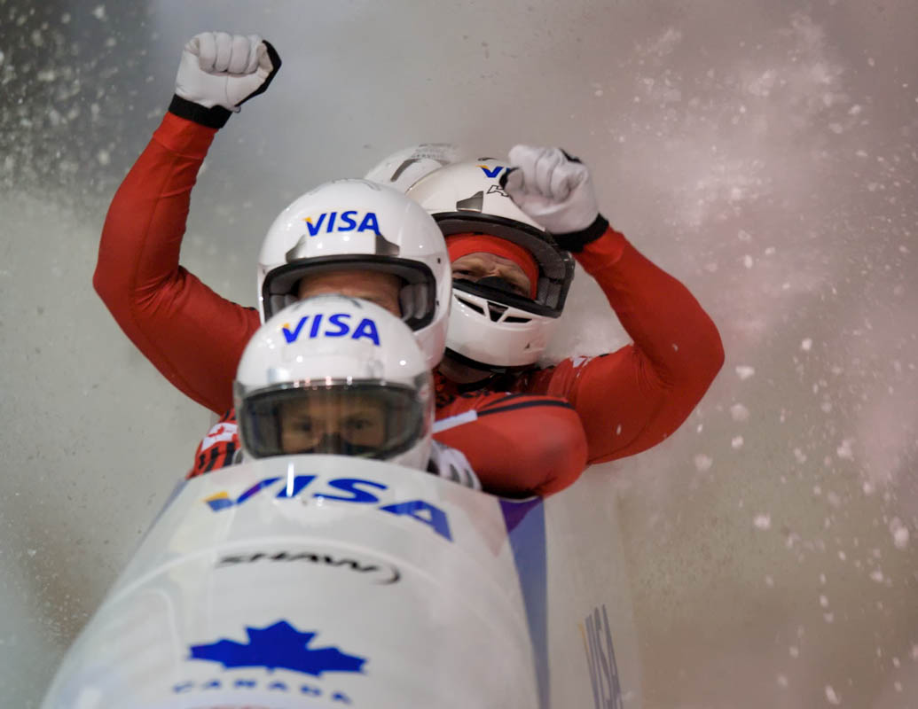 Driver Lyndon Rush of Canada and his team: Chris Le Bihan, Dan Humphries and Lascelles Brown celebrate after the finish of their second run as they won the 2009 World Cup Four Man Bobsled event at the Utah Olympic Park on November 14, 2009 in Park City, Utah.