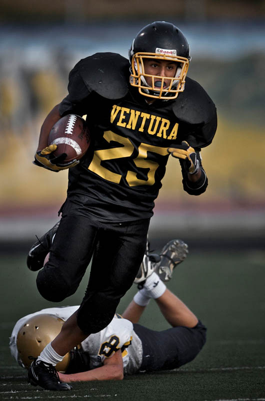 Ventura High School running back Ben Salazar runs down the side line during the third quarter during the Ventura vs Dos Pueblos game in Ventura , Calif., Wednesday, Nov. 5, 2009. The final score came to 12-13 as the Chargers tie for first place in the division.