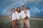 Rainbow stretches across the Isle of Palms for a beach photo session.