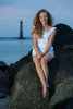 Folly Beach photo session.  Beach photography taken with Morris Island Lighthouse in the background.