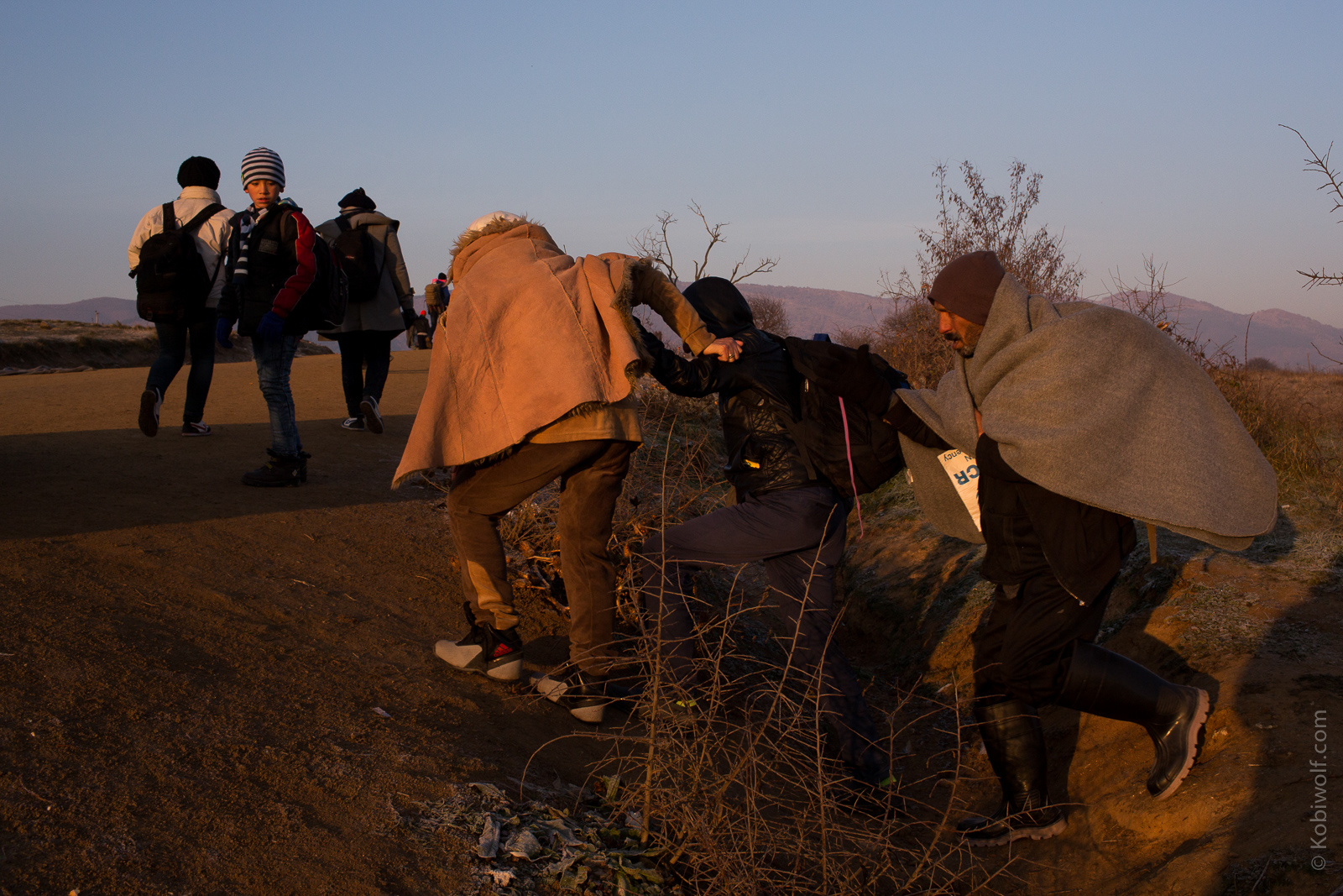 Syrian refugee make the harsh crossing from Macedonia to Serbia.