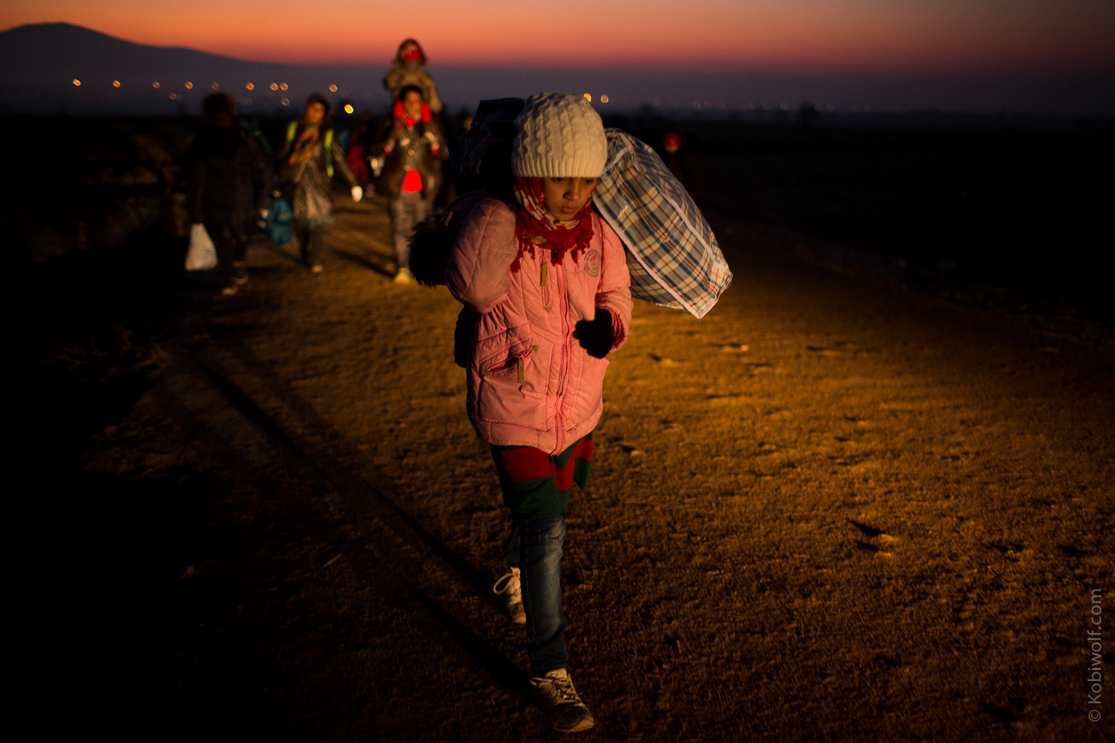 Young Syrian girl carrying the family's belongings, leading the way across the border to Serbia.