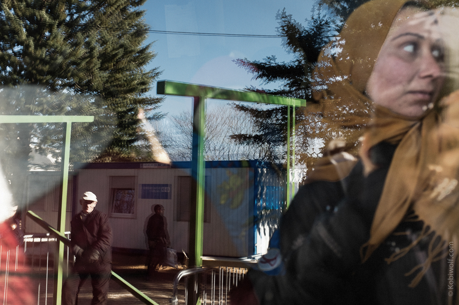 A reflection Syrian refugee woman outside the Medical centre in presevo, Refugees waiting for the registration in Presevo camp.