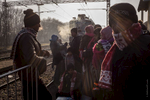 Refugee gets the train to Sid on Serbia Croatia border.
