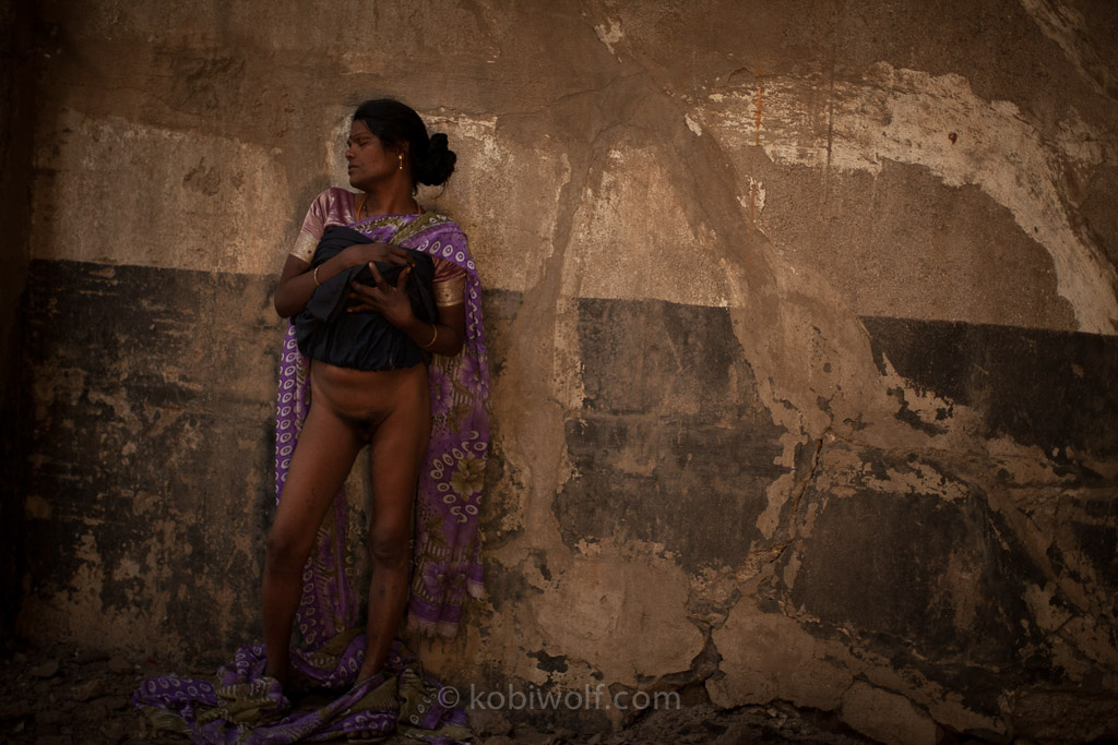 36 years old Hijra, waiting for customers near An abandoned building, in Kamahtipura, Mumbai she works as a prostitute 20 years