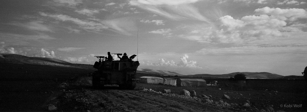 IDF Canon cross over a farmland during a training