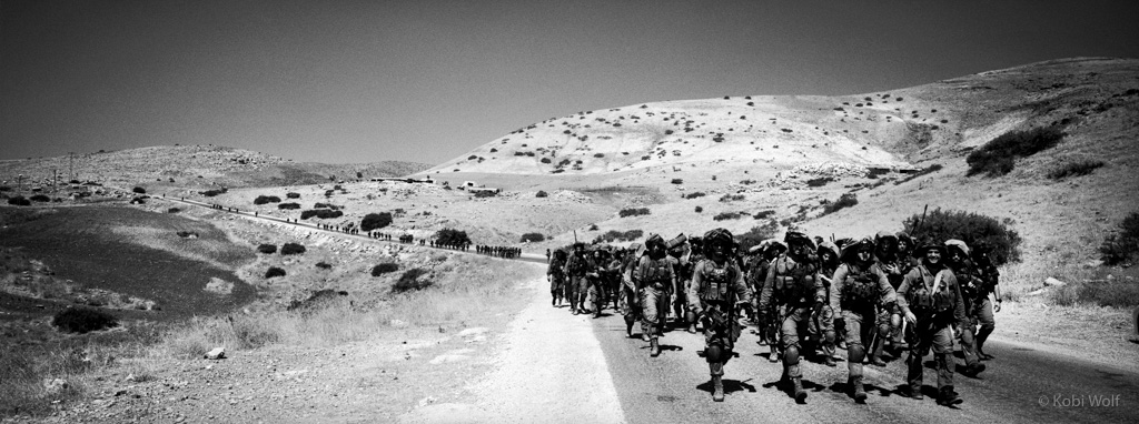Soldiers returning from army practice.