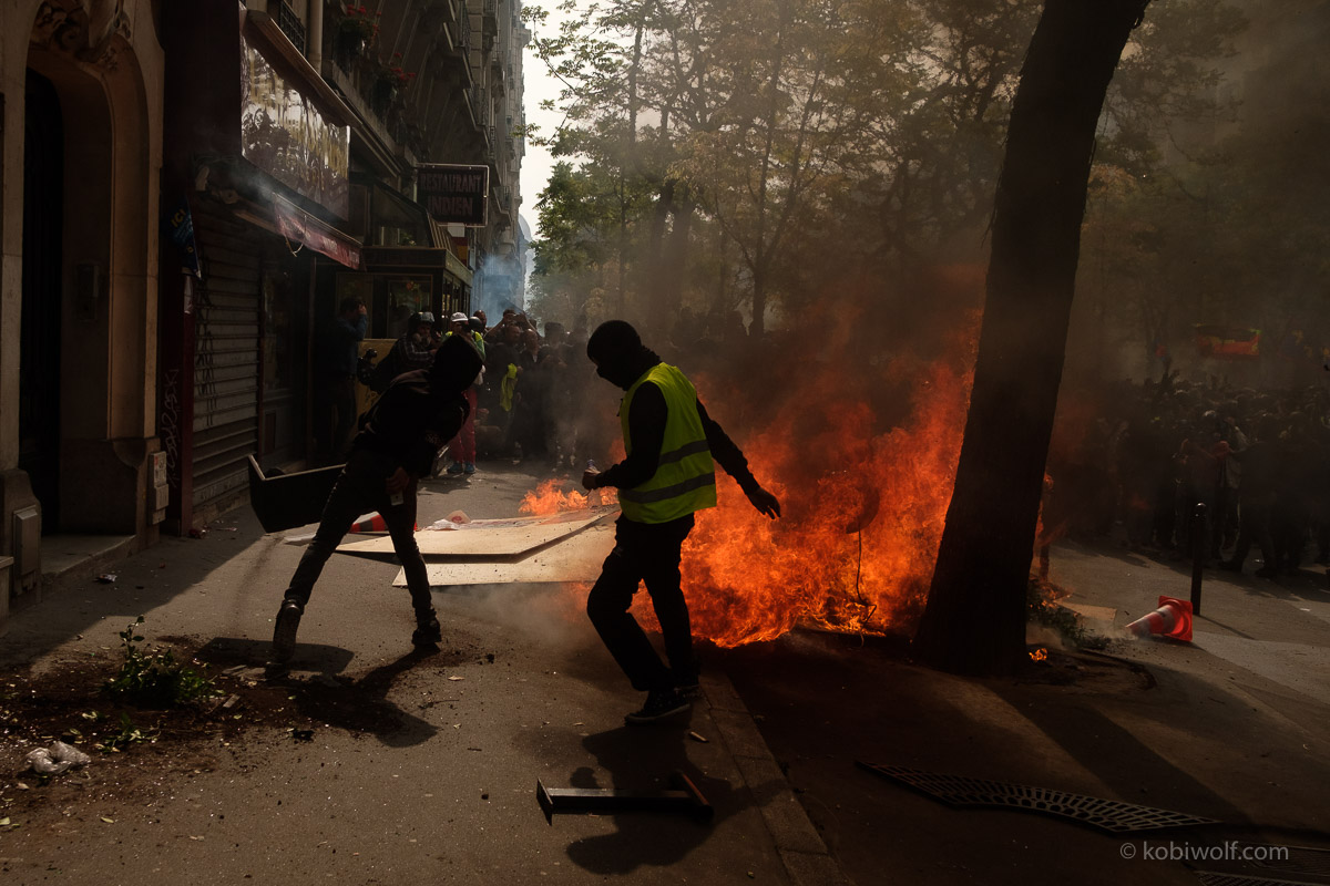 protestors kick tear gas shells back towards the police during International Labour Day as demonstrations turn violent on May 01, 2019 in Paris, France. May 1st and International Labour Day has given the Gilets Jaunes or 'Yellow Vests' the opportunity to mark Act 25 of protests, the first since November 17, 2018 not to take place on a Saturday.