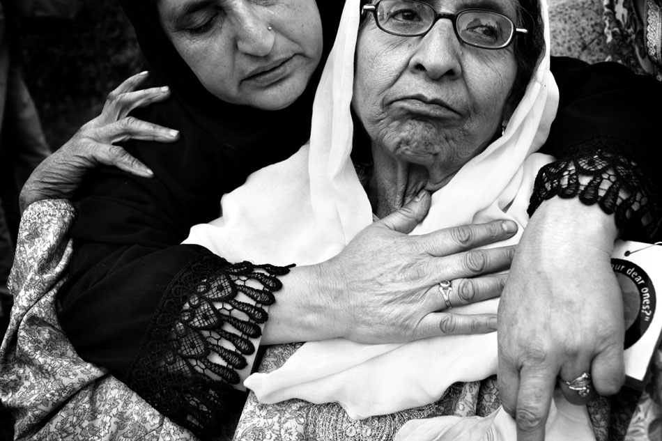 Name: unknown. The  woman, who lives in Haba Kadal in downtown Srinagar, has lost her son, Nazir Ahmad. Nazir was a school teacher. One day, on his way to school, he was arrested by the Indian police. He has since disappeared