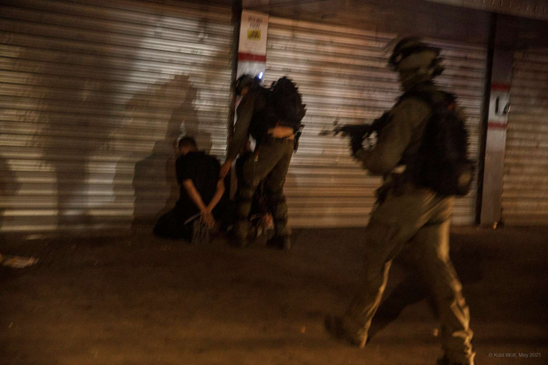 Israel police forces arrest Israel Arab from Lod during a riot in the Lod,central Israel, Thursday, May 13, 2021 photographer: Kobi Wolf