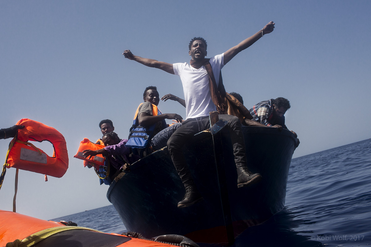 A migrant reacts after being rescued by the Ngo organization' members of Proactiva open Arms.