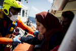 A Syrian refugee brought into the Italian coast guard boat on her way to lampedusa island in Italy.
