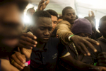 Africans Migrants Fighting for a bottle of water on the deck of the Procativa open arms ship  after being rescued in the central Mediterranean, in international waters off the Libyan coastal town of Sabratha.