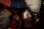 Africans Migrants rest on the deck of the Procativa open arms ship  after being rescued in the central Mediterranean, in international waters off the Libyan coastal town of Sabratha.
