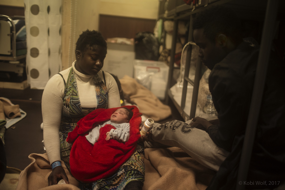 African Migrants from Senegal holding her baby in the {quote}hospital{quote} of the Procativa open arms ship  after being rescued in the central Mediterranean, in international waters off the Libyan coastal town of Sabratha.
