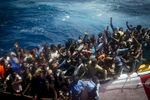 Refugees and immigrants in the Italian coast guard ship on thrie way to lampedusa island in Italy.
