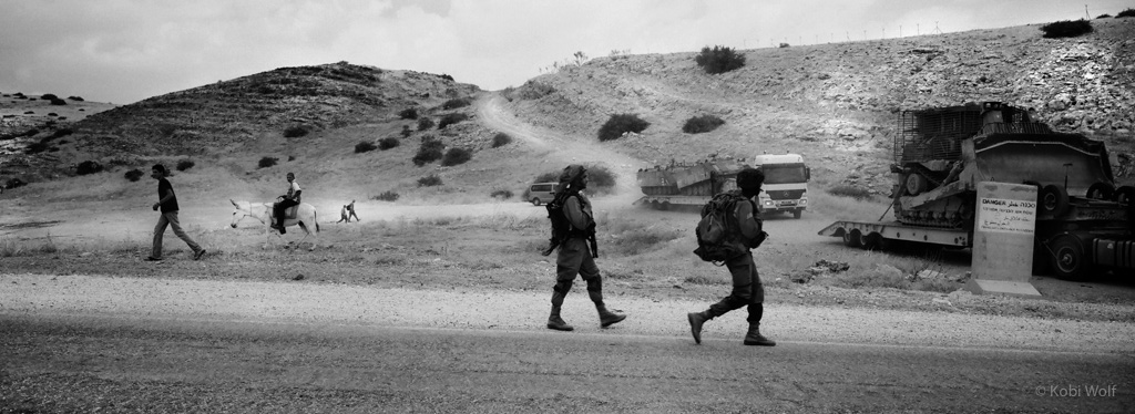 IDF Soldiers cross over a Palestinian farmland during a training