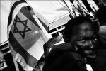 A Darfuree refugee demonstrates during the International day for Darfur 2008 in Tel Aviv. Some 900 refugees from war torn Darfur reached Israel in the past 4 years