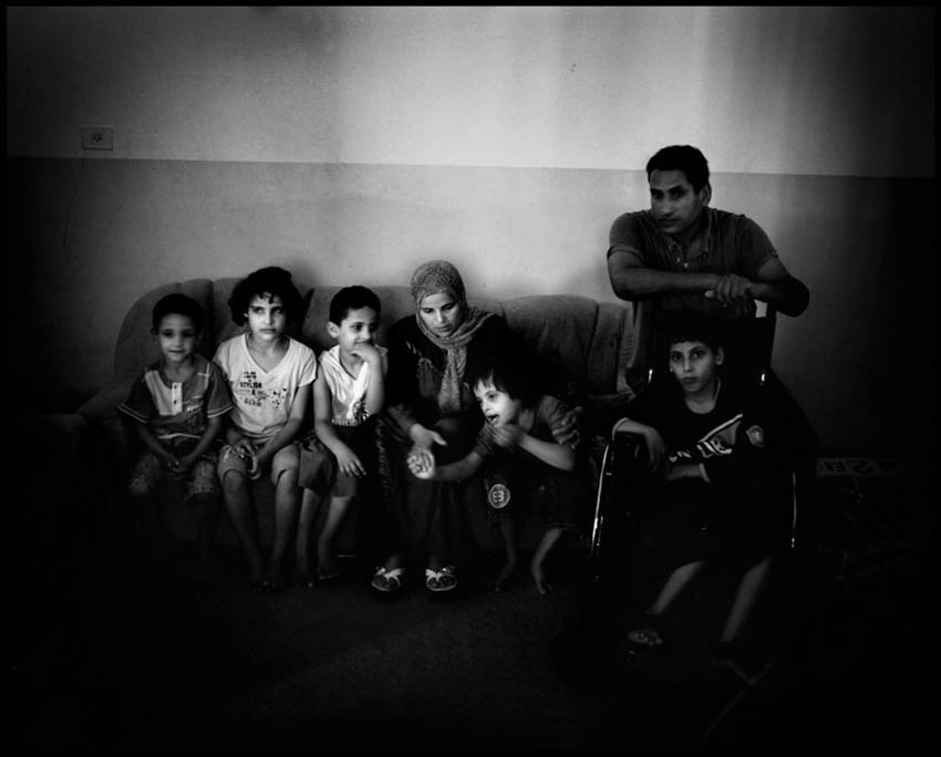 Al Frijad family. Four of the family's children were born with defects and severe illnesses. 10 year old Zahi is in a wheel chair. His twin brother Rami was born with severe retardation. 6 year old Ibrahim suffers from mild retardation and 5 year old Imad was born with a crippled leg.
