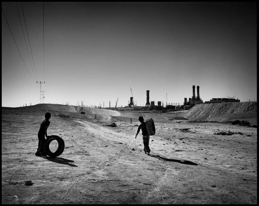 Kids playing at Wadi al-Na'am. Ramat Hovav, Israel's hazardous industrial park and waste disposal facility, which currently encompasses 14 hazardous agro and petro-chemical factories, is just 1 km away from the village. High rates of acute illnesses were found among the villagers.