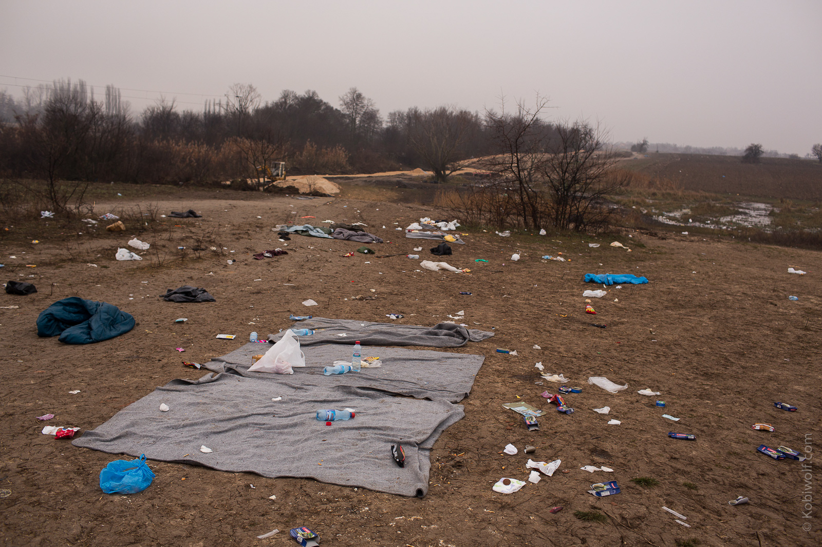 Blankets, sleeping bags, empty bottles and food wrappers left on the ground, after scores of refugees spent the night out in 0 Celsius temperatures