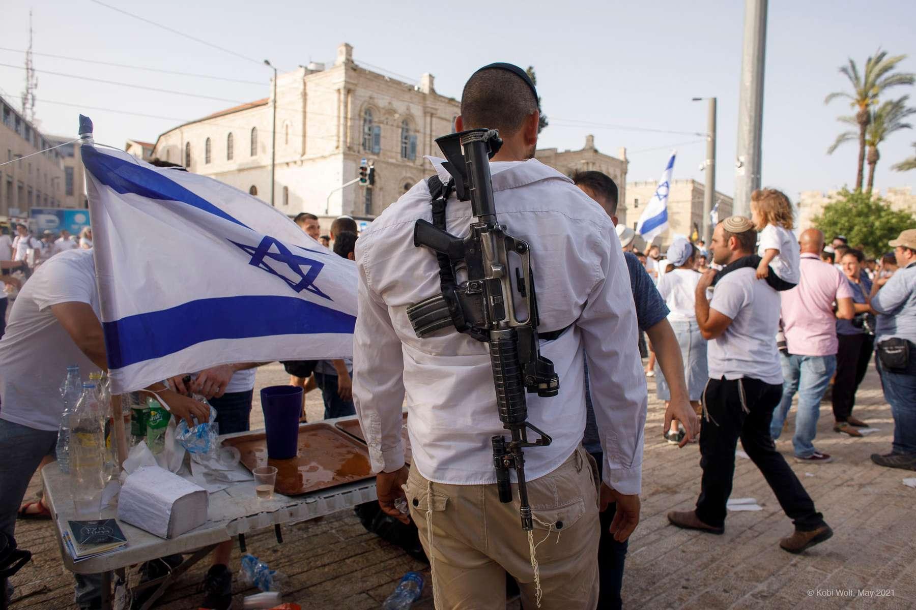 Israelis march with national flags celebrating the Jerusalem liberation day in Jerusalem May 10 2021 photographer : Kobi Wolf
