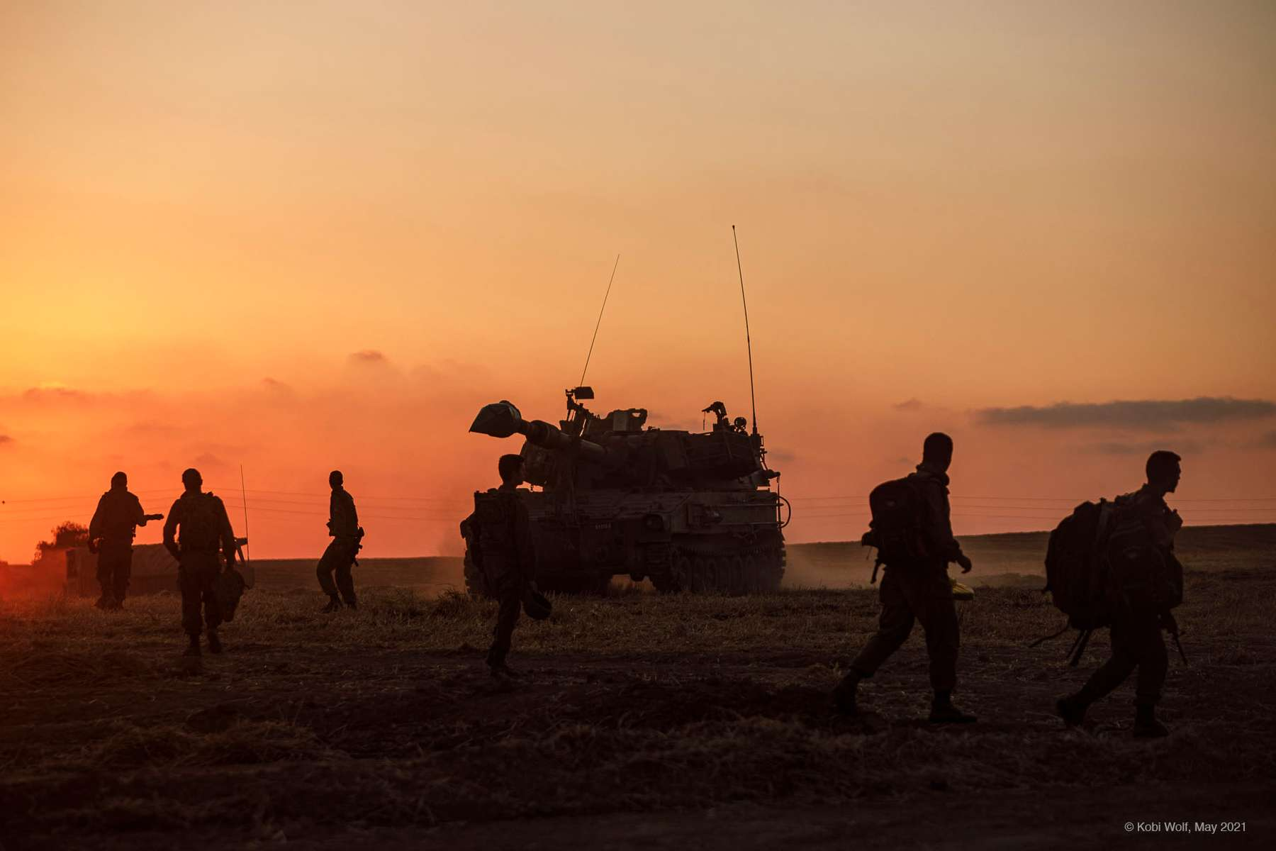 Israeli soldiers beside a cannon In Gaza border Israel, Thursday, May 14, 2021 photographer: Kobi Wolf