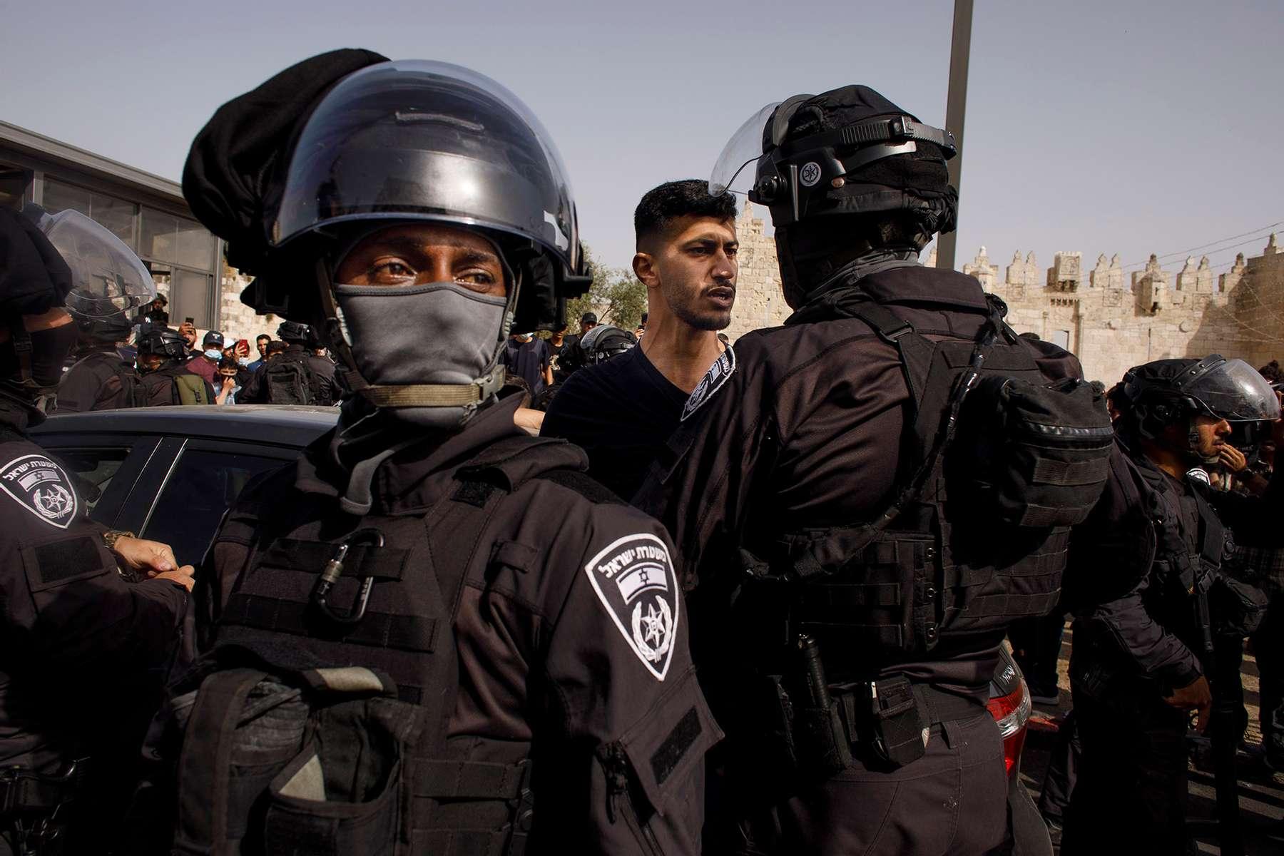 Israeli police checking a Palestinian driver near Damascus Gate
