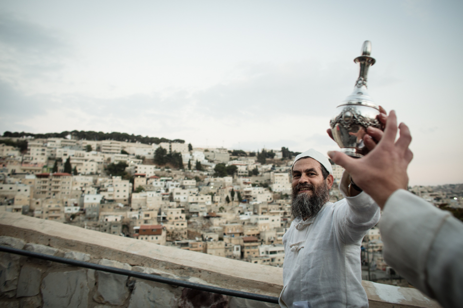 The Priest holding the golden pitcher in The arab neighborhood Silwan. The Feast of Tabernacles required sacrifices of sin offerings and burnt offerings. At the time of preparation for the morning sacrifice, a priest would descend to the Pool of Siloam—amidst great music, celebration and fill a golden pitcher with water.