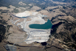 Overview of the Tunnels Mine.  Open pit at the top, tailings pond and dam at the center.