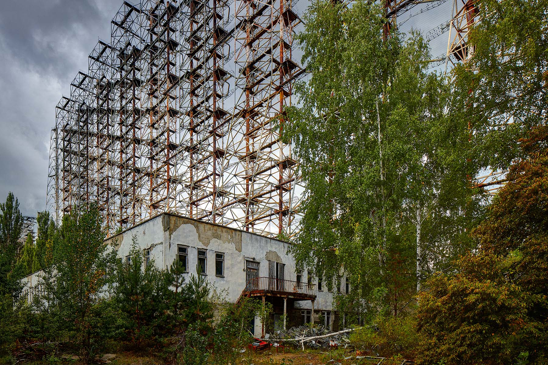 Duga 1 was a major part of the Soviet early warning radar designed to detect nuclear attack from the West. Its intricate antenna juts out from the forest measuring 150x500 metres. Despite being in Ukraine, it was  refered to in the west as the 'Russian Woodpecker' because of the strange stocatto taps that it created in short wave radio bands around the world. Situated inside what is now the Chernobyl exclusion zone, it is eerie to see the illustrations of NATO warheads in what was a hotlink to the Soviet nuclear command.