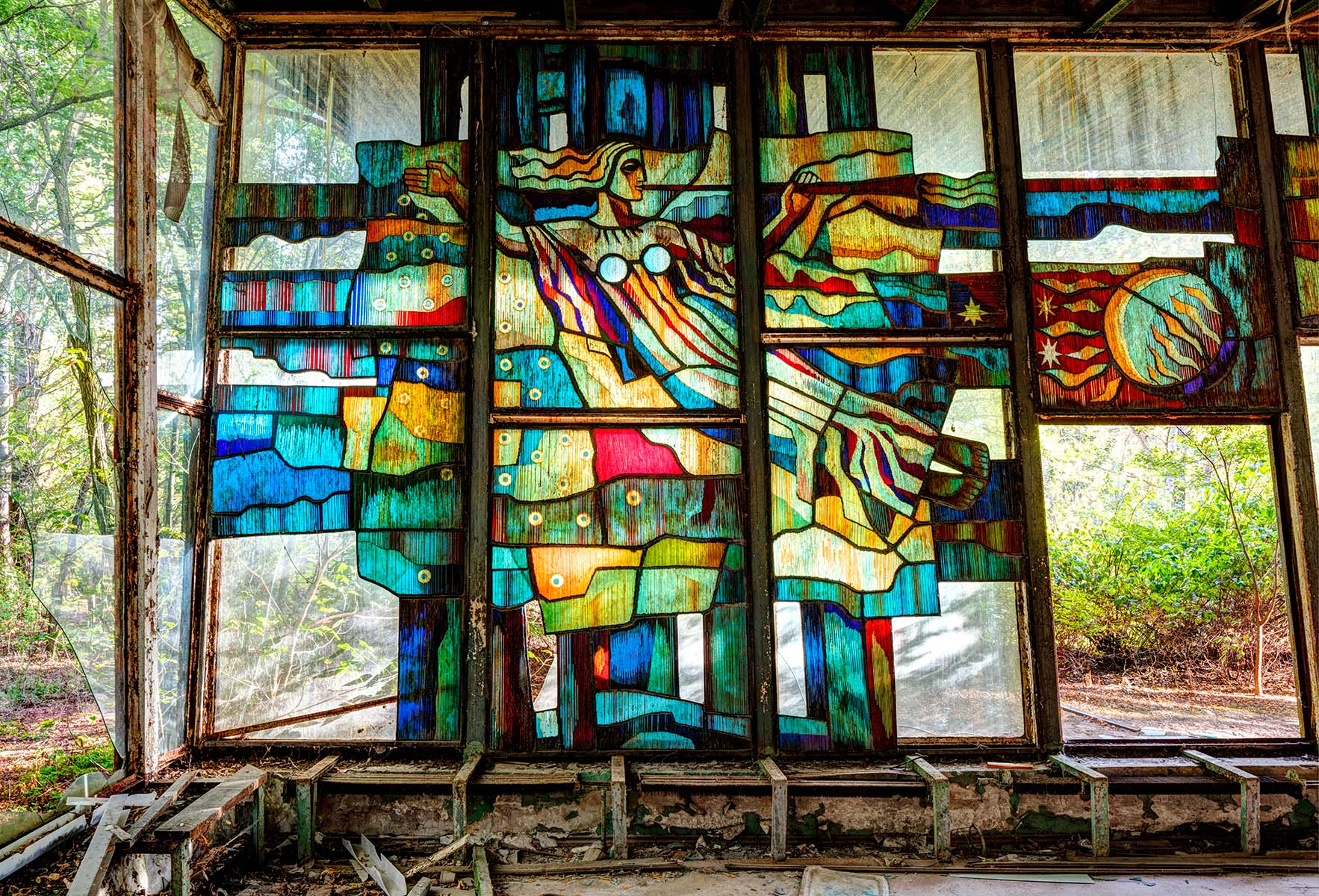 This would have been a nice cafe on the waterfront with vibrant stained glass windows. Despite its tragic fate, Pripyat was a utopian new town designed to house the skilled workers and scientists at the power plant. It had excellent leisure and cultural facilities and was set in an area of natural beauty. You can imagine that the people living here would have been happy.