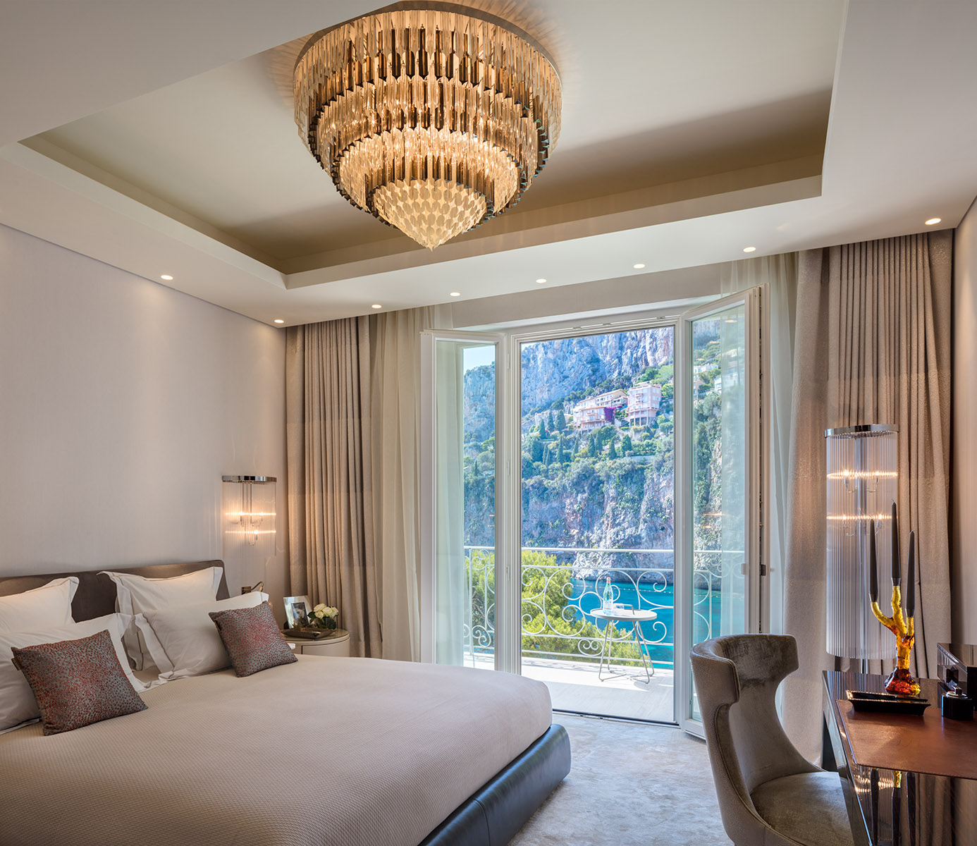 Guest bedoom with sunlit view to sea and cape in luxurious super-prime Villa built into cliff at premier location next to Monaco.