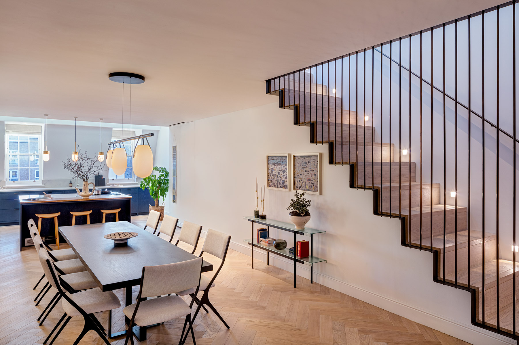 Photograph Contemporary apartment converted from Georgian terrace next to Covent Garden Market. Dining area and kitchen with suspended stairs leading up.